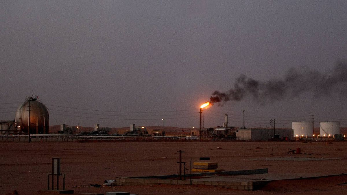 "A flame from a Saudi Aramco (the national oil company) oil installation known as ""Pump 3"" burns brightly during sunset in the Saudi Arabian desert near the oil-rich area Al-Khurais, 160 kms east of the capital Riyadh, on June 23, 2008."