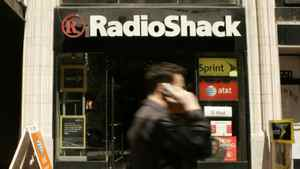A man walks past a RadioShack location in this file photo.