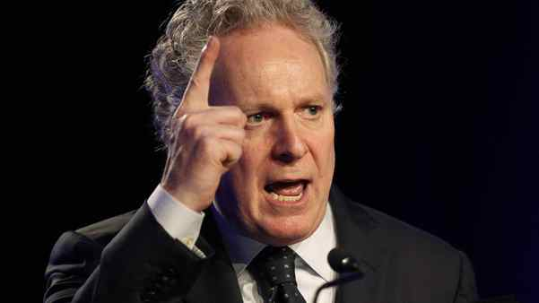 Quebec Premier Jean Charest gives an opening speech at a convention for the members of Quebec's Liberal Party at the congress center in Quebec City October 21, 2011.