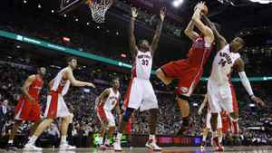 Toronto Raptors Sonny Weems and Ed Davis guard Los Angeles Clippers Blake Griffin during the second half of their NBA basketball game in Toronto.