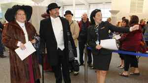 Stephen and Judy Keast of Melbourne, Australia arrive wearing period costume before boarding the Titanic Memorial Cruise in Southampton, England April 8, 2012.