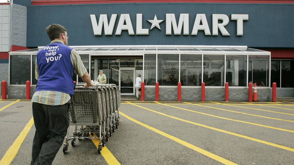 A Wal-Mart employee pushes a line of shopping carts toward the entrance of a Wal-Mart store, in Walpole, Mass., in this May 11, 2007 file photo. Growth in the U.S. service sector slowed in March.