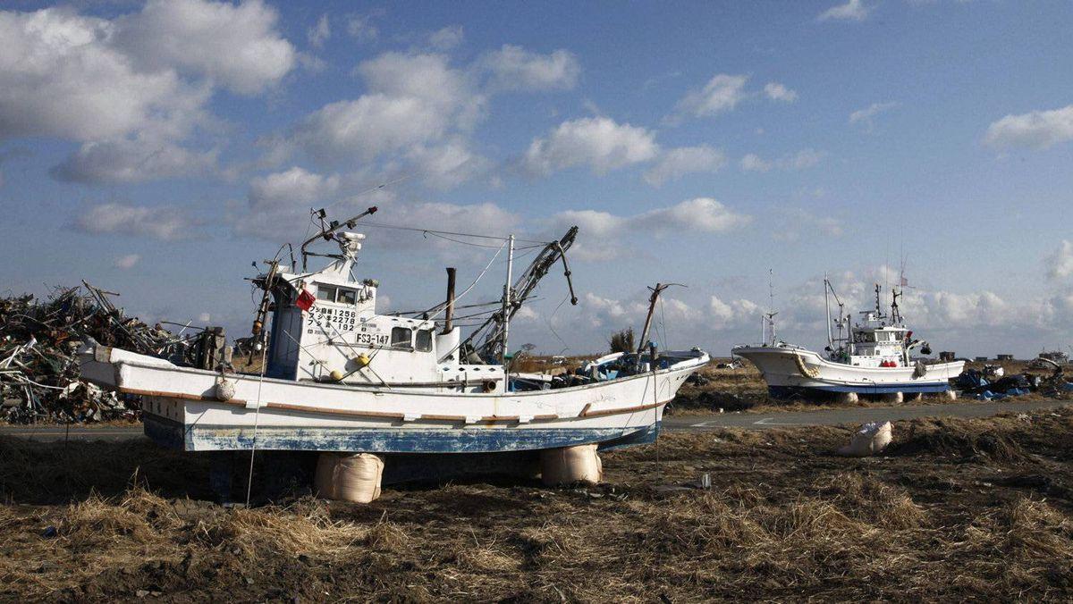 Tsunami-devastated ships and debris are seen inside the exclusion zone of a 20-kilometre radius around the crippled Fukushima Daiichi nuclear power plant in Fukushima prefecture, Japan.