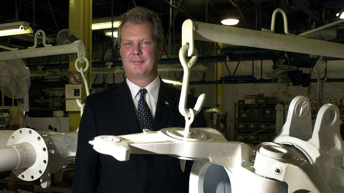 Gilles Labbe, president of Heroux-Devtek, stands behind landing gear in the company's Longueuil, Que. office in this file photo.
