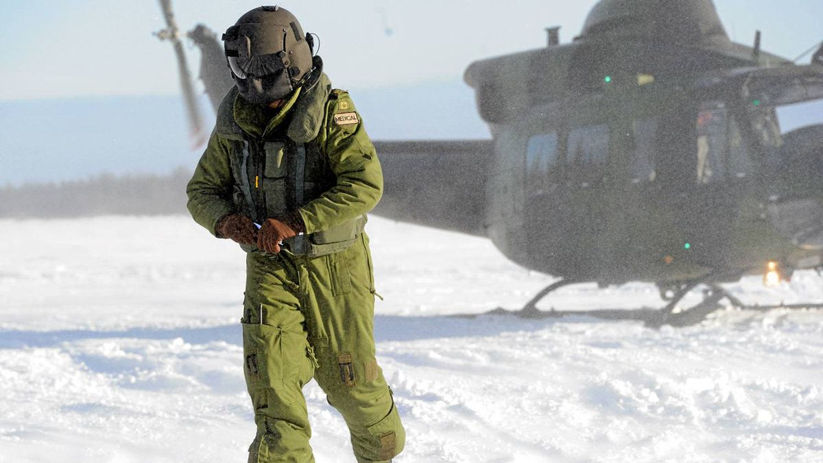 A paratrooper hits the ground a few seconds after Charlie Company of the 3rd Battalion of Princess Patricia's Light Infantry (PPCLI) jump out of the side door of a C-130 Hercules during Exercise ARCTIC RAM.