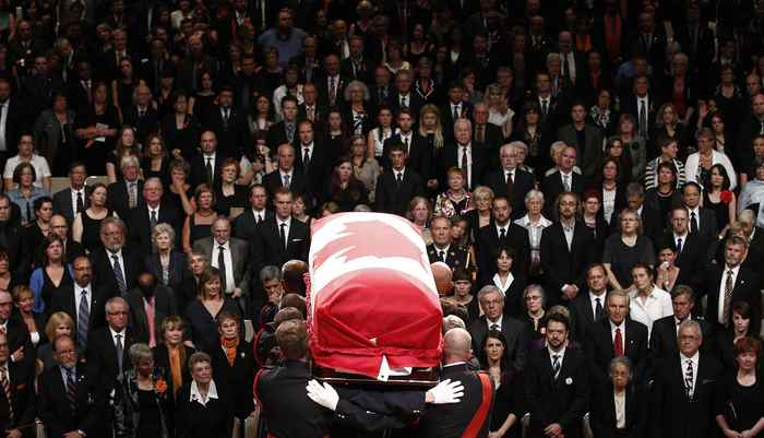 The coffin containing NDP Opposition Leader Jack Layton is carried away at the end of his state funeral.