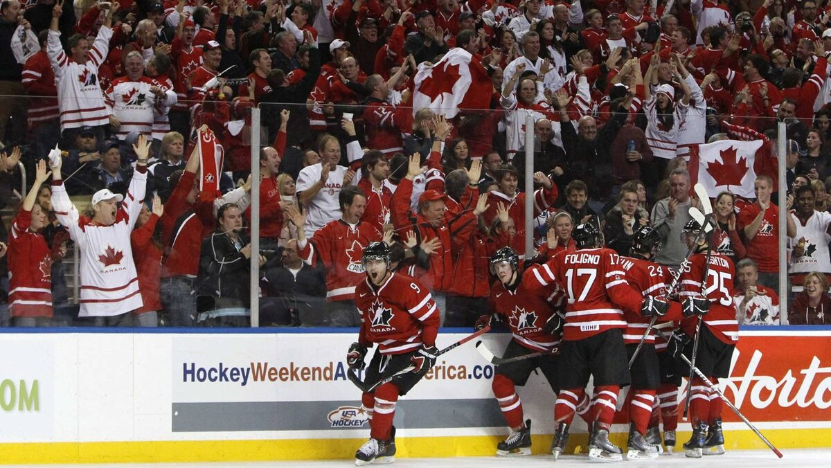 Canada's Zack Kassian celebrates with teammates after scoring on the USA during the third period of their semi-final game.