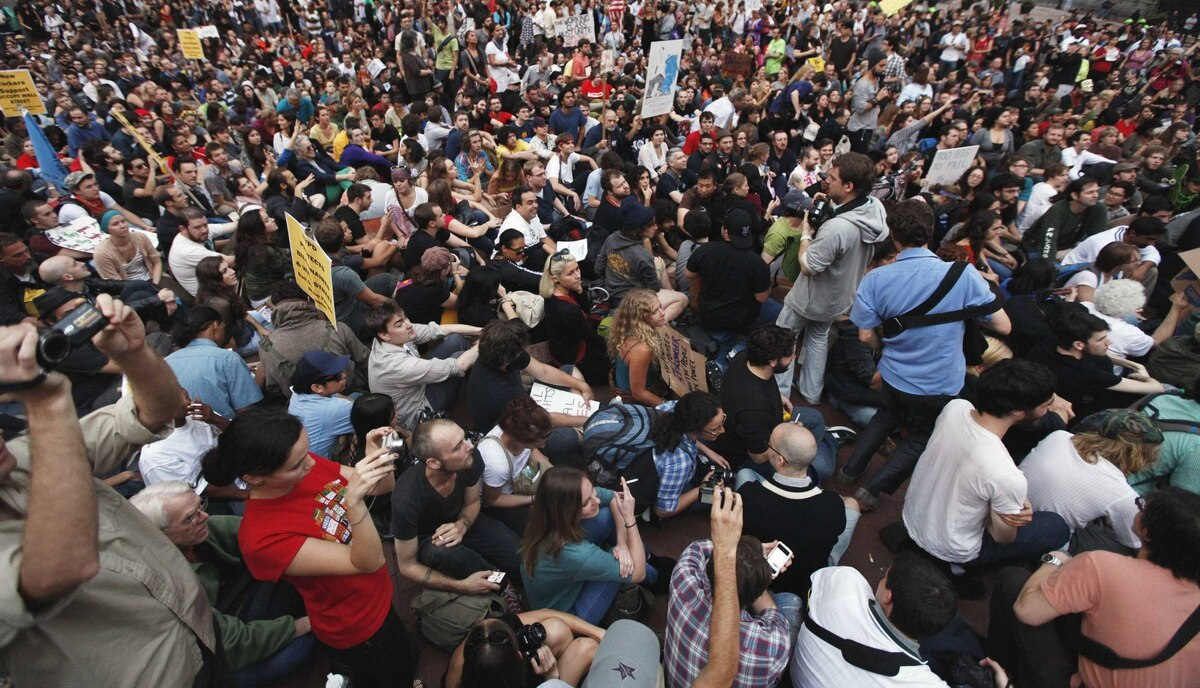 Demonstrators from the Occupy Wall Street campaign sit down near One Police Plaza in New York September 30, 2011.