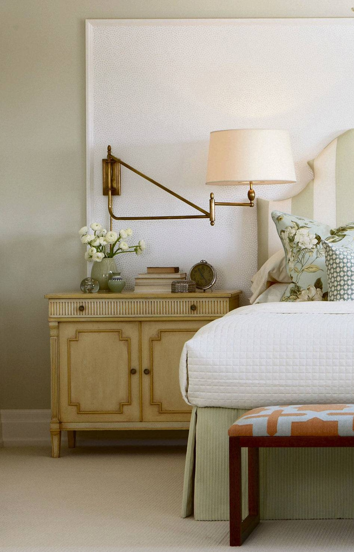 LEND IMPACT TO A BARE WALL Install a simple trim profile to create an oversized panel and then apply a decorative wallpaper. It's easier and cheaper than covering the entire wall and allows you to layer two shades against each other. Add a contemporary touch with over-scaled swing-arm lamps.