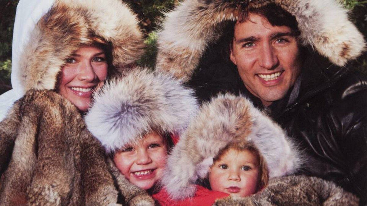 Liberal MP Justin Trudeau poses with his family on his annual Christmas card wearing a fur parka.