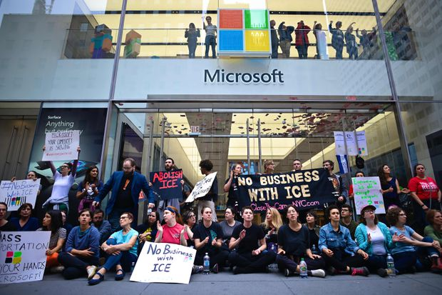 Over 70 arrested in immigration protest at Microsoft store