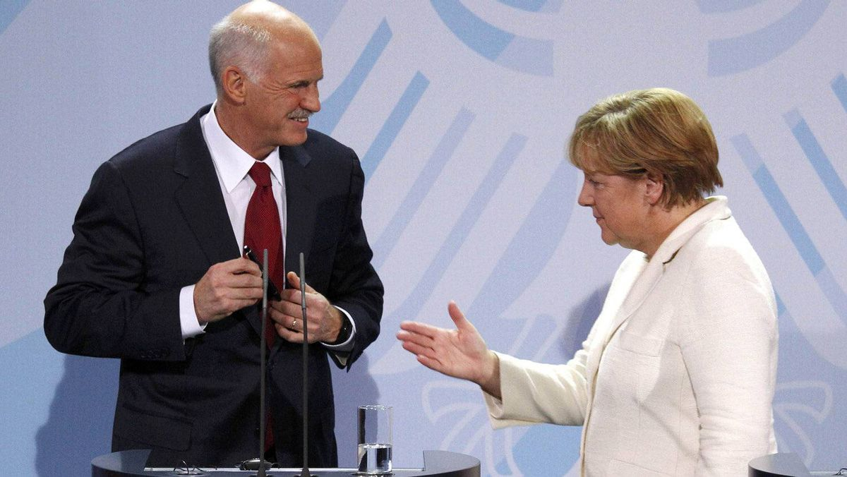German Chancellor Angela Merkel, right, and Greek Prime Minister George Papandreou talk after speaking to reporters at the Chancellery in Berlin on Tuesday.