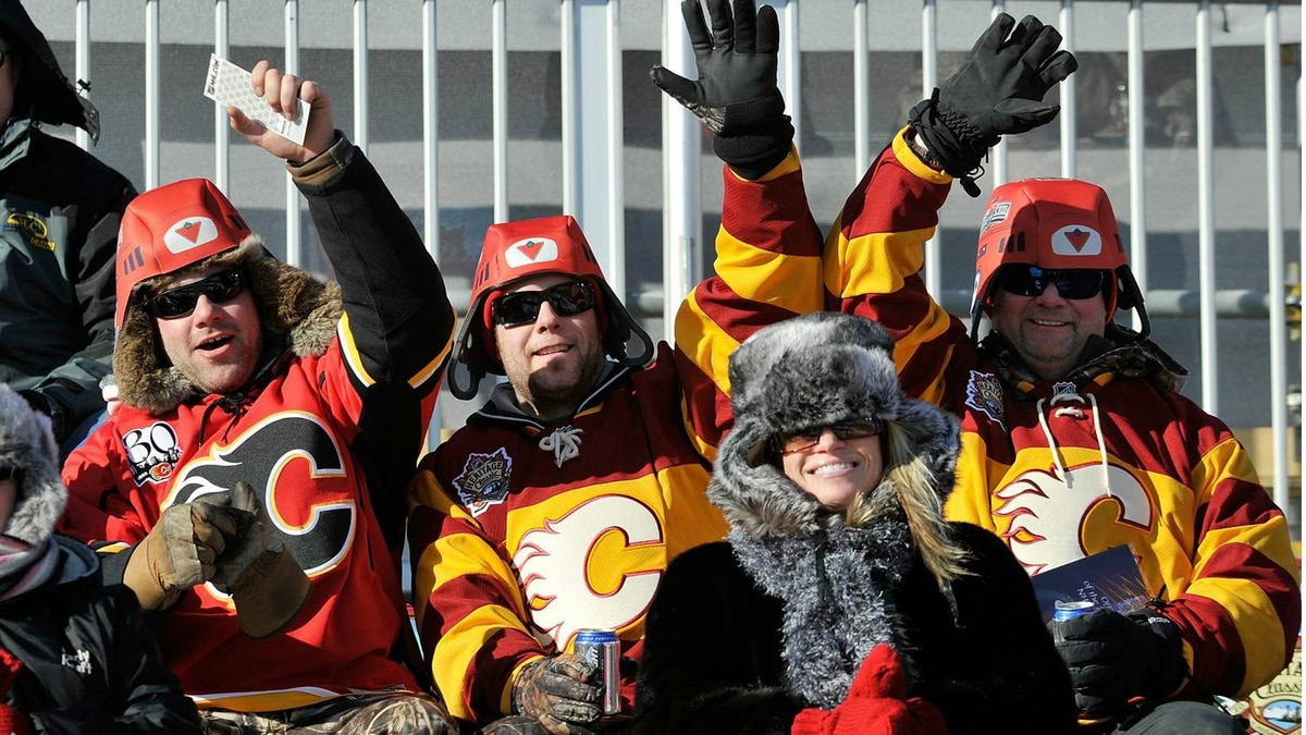 Calary Flames fans wait for the arrival of the teams for the 2011 NHL Heritage Classic Game at McMahon Stadium on February 20, 2011 in Calgary, Alberta, Canada. (Photo by Dylan Lynch/Getty Images)
