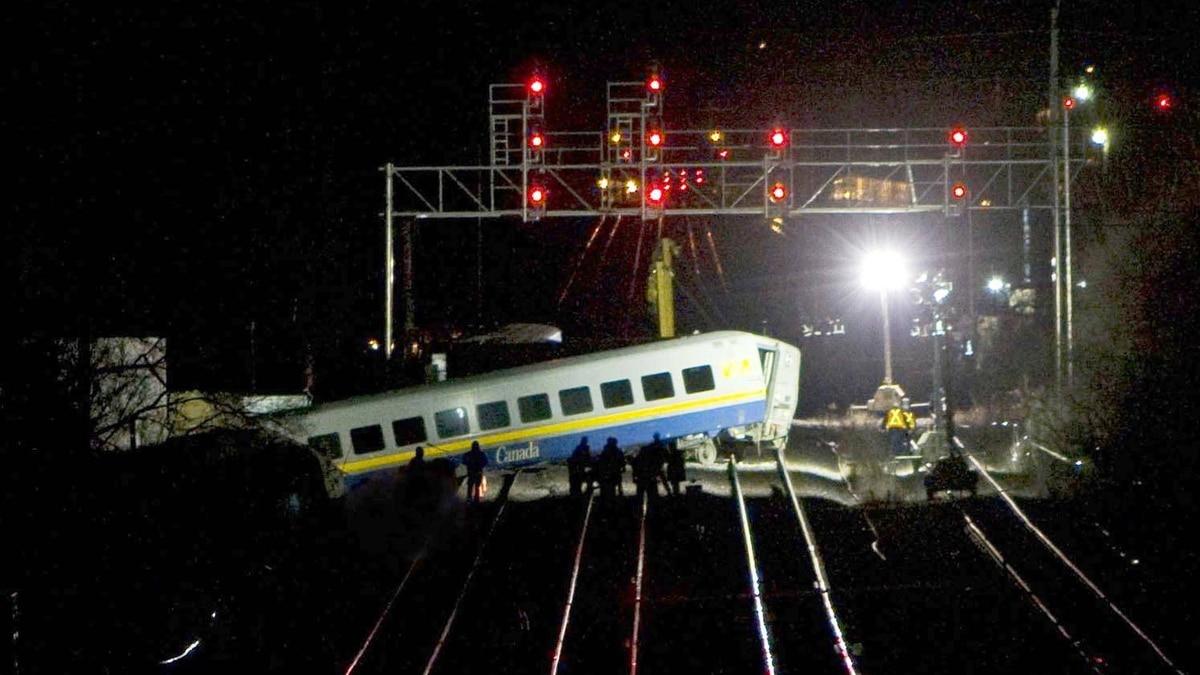 Emergency personnel work at the scene of VIA Rail derailment in Burlington Ont., on Feb. 26, 2012. Matthew Sherwood/Reuters