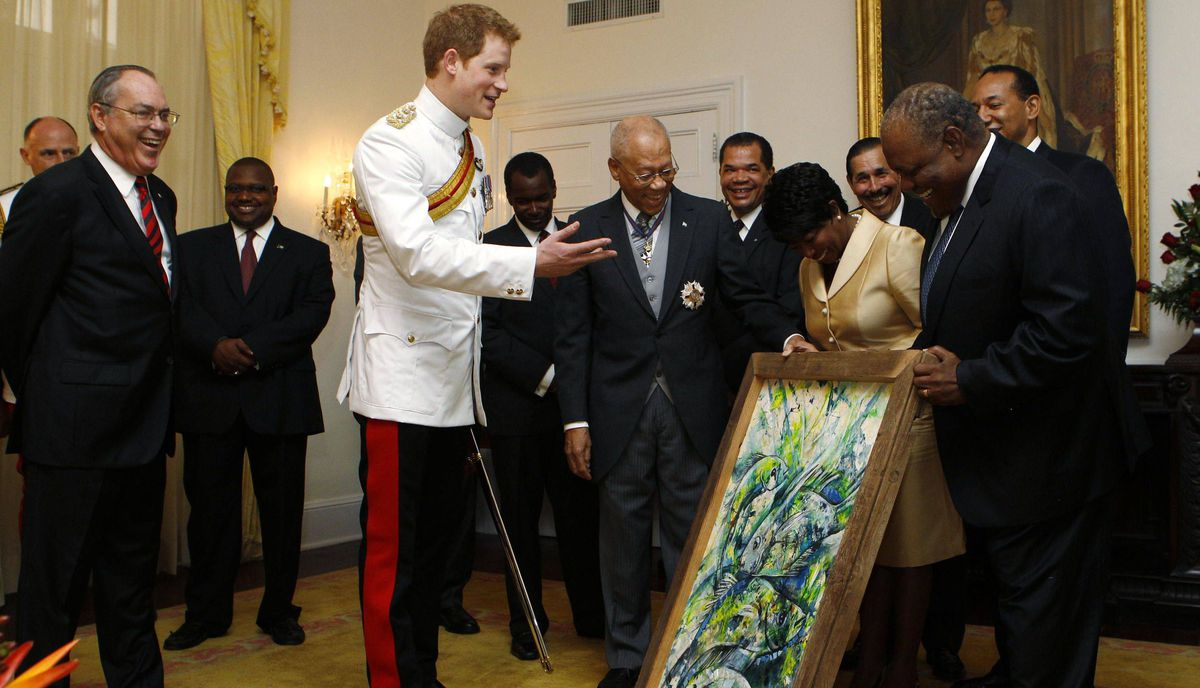 Prince Harry accepts a gift during a reception at Government House in Nassau on March 4, 2012.