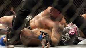 Minotauro Nogueira has his arm broken by Frank Mir (top) during UFC 140 in Toronto on Saturday December 10, 2011. UFC heavyweight champion Junior Dos Santos has given former title-holder Mir extra motivation for their main event showdown at UFC 146, according to welterweight Dan (The Outlaw) Hardy. THE CANADIAN PRESS/Chris Young