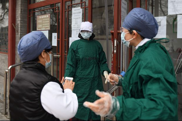 China sees fewer suspected cases of COVID-19