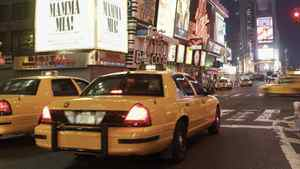 Taxis driving through times square in New York.