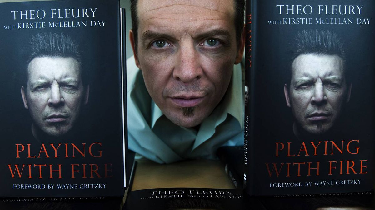 Former NHL hockey star Theoren Fleury poses for a photograph with his new booked called 'Playing With Fire' in Toronto on Wednesday, Oct. 14, 2009.