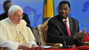Pope Benedict XVI prepares speaks next to Benin's President Thomas Yayi Boni (R) at the Presidential Palace in Cotonou on Nov. 19, 2011.