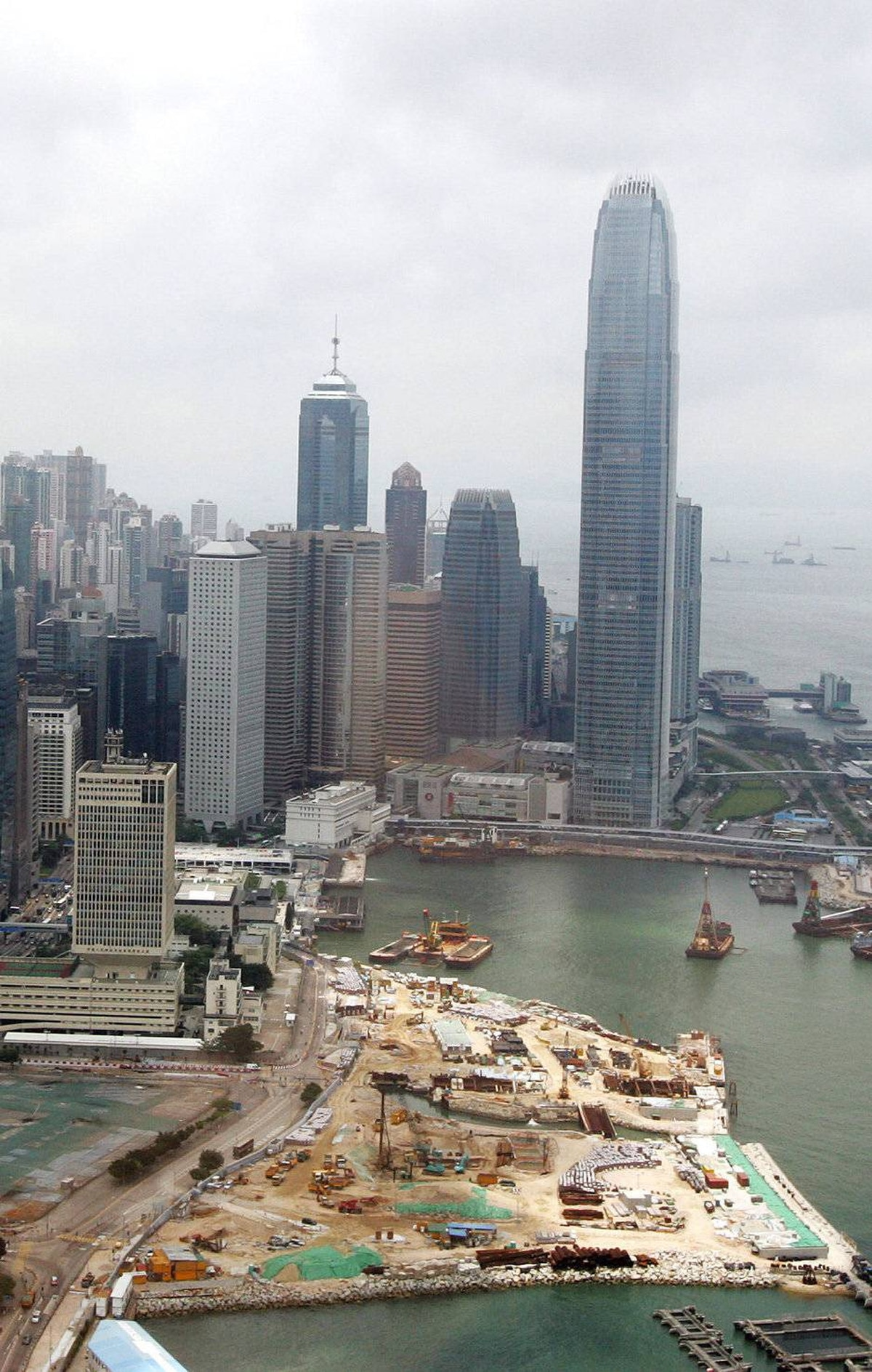 This photo shows the reclamation work on Victoria Harbour and a view of its skyline, including the city's International Financial Center (IFC) building (back R), in Hong Kong, 26 May 2007.