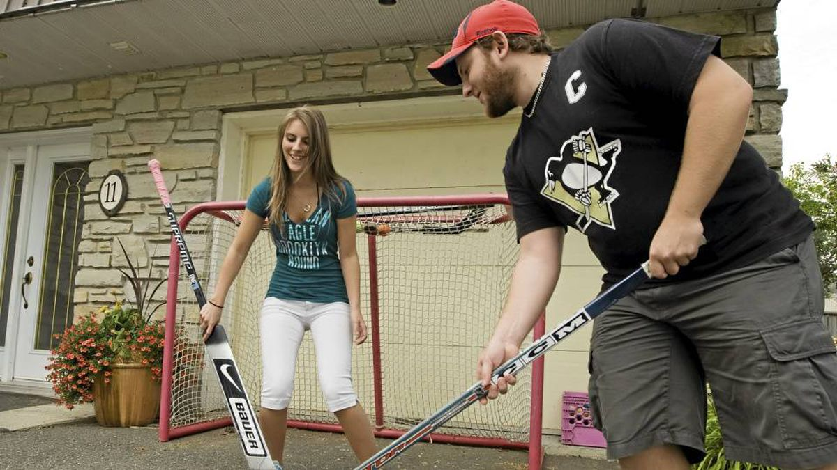 Florence, left, and Olivier Dallaire-Turmel, right, aged 18 and 20 played hockey at home