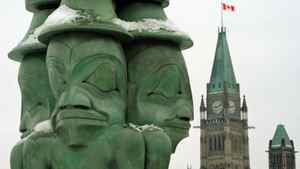 Haida artist Chief James Hart's sculpture The Three Watchmen graces Parliament Hill on Jan. 23, 2012 ahead of a landmark Crown-first nations gathering.