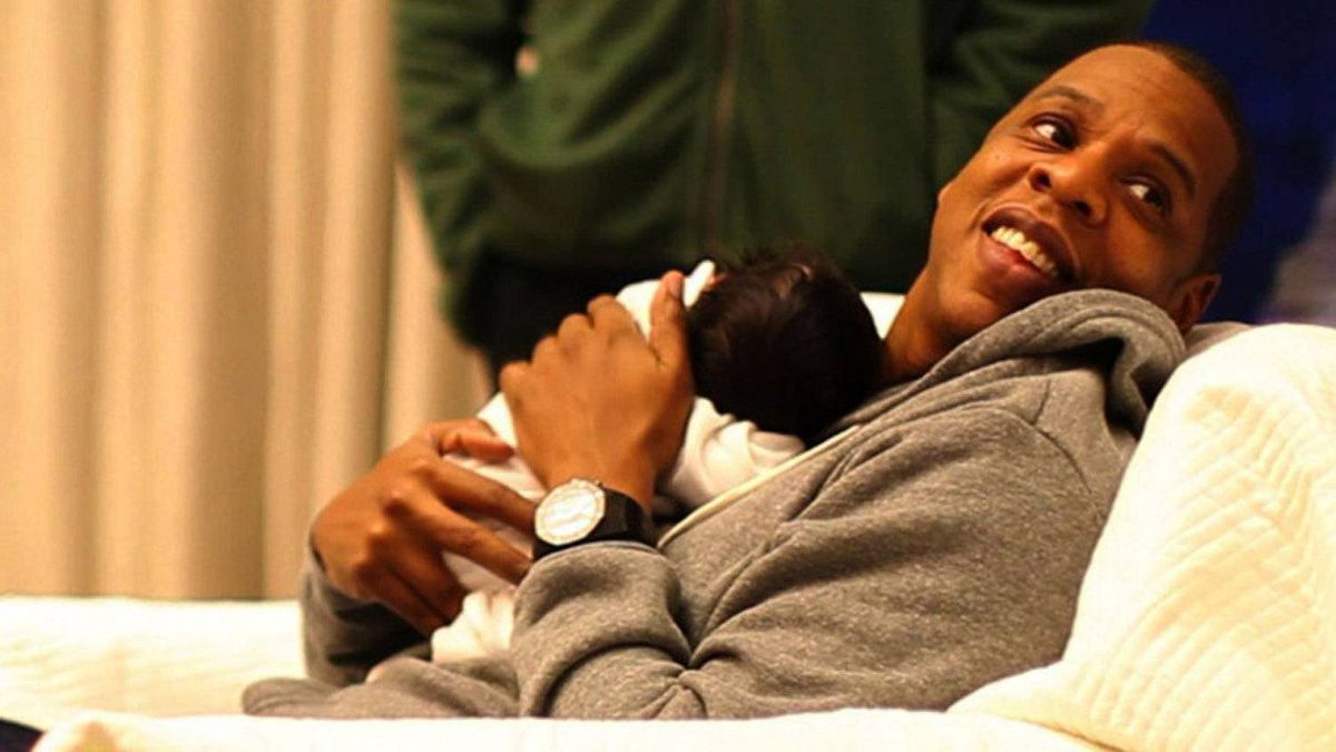 In this undated image released by Beyonce.com, rapper Jay-Z holds his daughter with singer-wife Beyonce Knowles, Blue Ivy in a recent family photo.