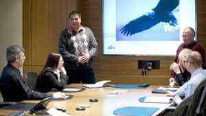 Consultant Tom Erasmus, standing left, leads an aboriginal awareness training session at Newalta Corp. in Calgary.