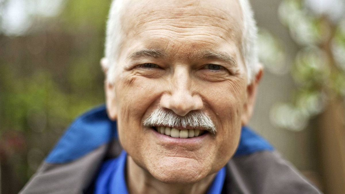 Jack Layton shows off his trademark grin outside his Toronto home on May 10, 2011, after leading the NDP to Official Opposition status.