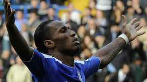 Chelsea's Didier Drogba celebrates after scoring against Stoke City during their English Premier League soccer match at Stamford Bridge in London March 10, 2012. REUTERS/Paul Hackett