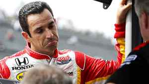 IndyCar driver Helio Castroneves of Brazil chats with his team members during the second practice for the Indy Japan auto race at Twin Ring Motegi in Motegi, northeast of Tokyo. Castroneves has lashed out at IndyCar chief steward Brian Barnhart after the Brazilian driver was penalized in Sunday's Indy Japan.