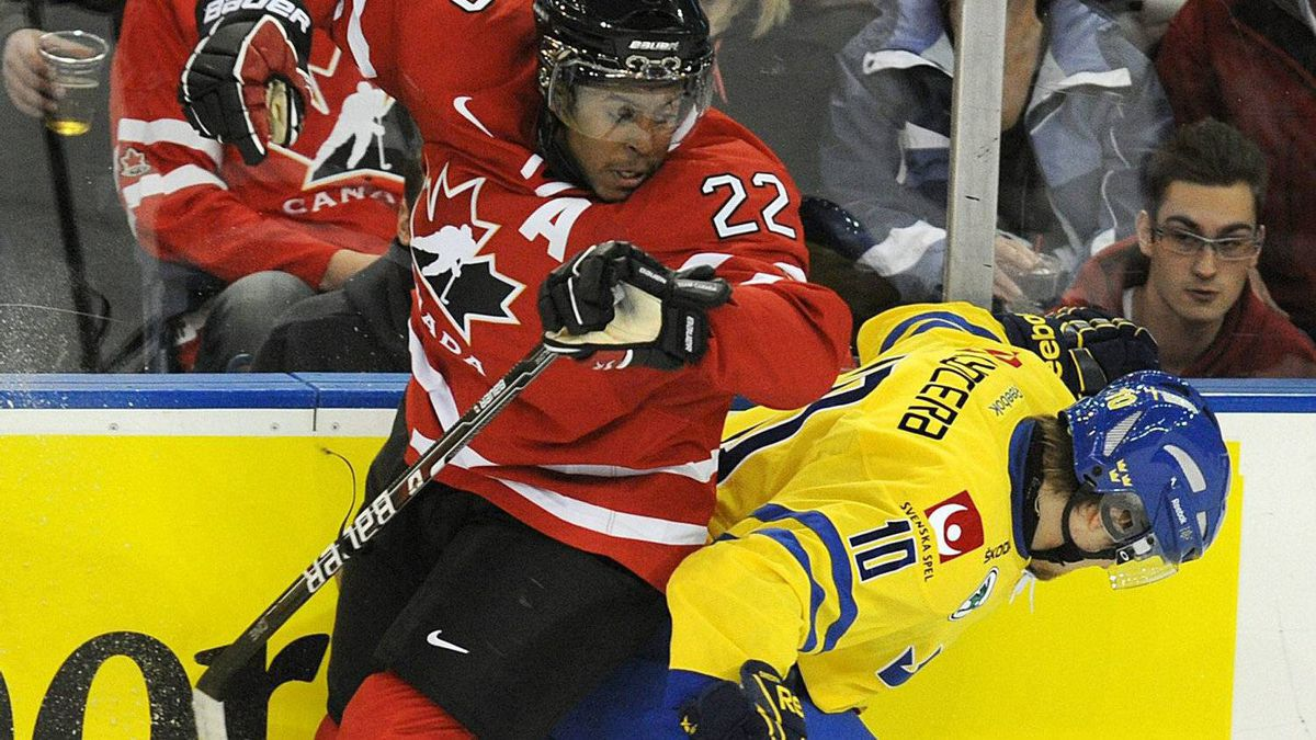 Team Canada Devante Smith-Pelly, left, battles against Team Sweden's Johan Larsson during first period exhibition hockey action in preparation for the upcoming IIHF World Junior Championships in Edmonton, Alta., on Friday, Dec. 23, 2011. THE CANADIAN PRESS/John Ulan