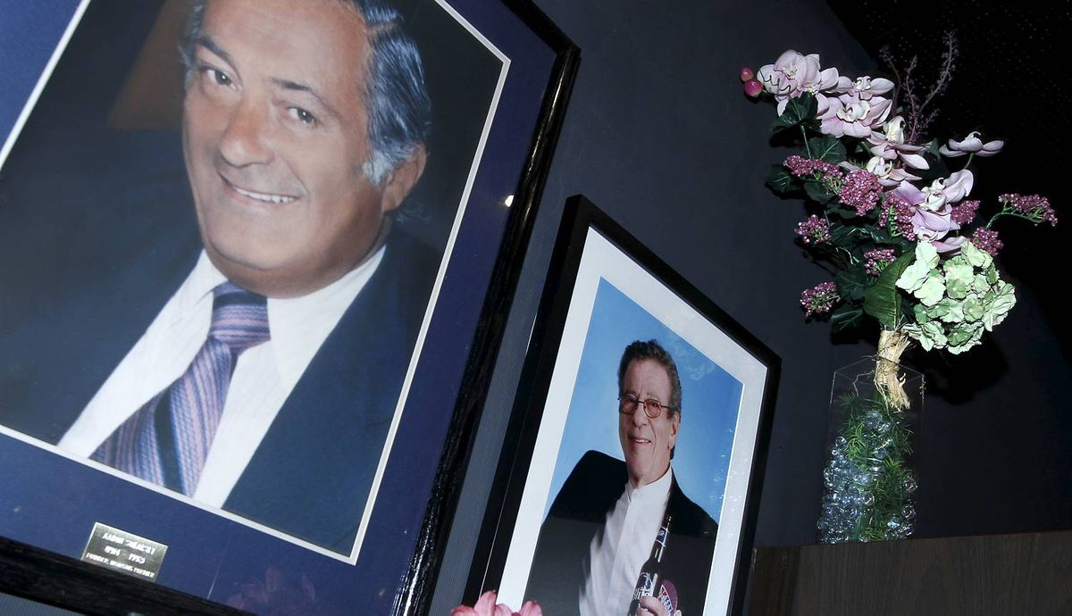A portrait of Donald Lyons, former owner, hanging on the wall, at right, alongside a photo of one of the founding managing partners, Aaron Sokalsky, left.