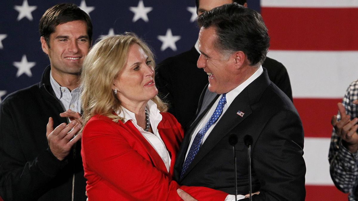Republican presidential candidate and former Massachusetts Governor Mitt Romney hugs his wife Ann as his sons look on at his Iowa Caucus night rally in Des Moines, Iowa, January 3, 2012.