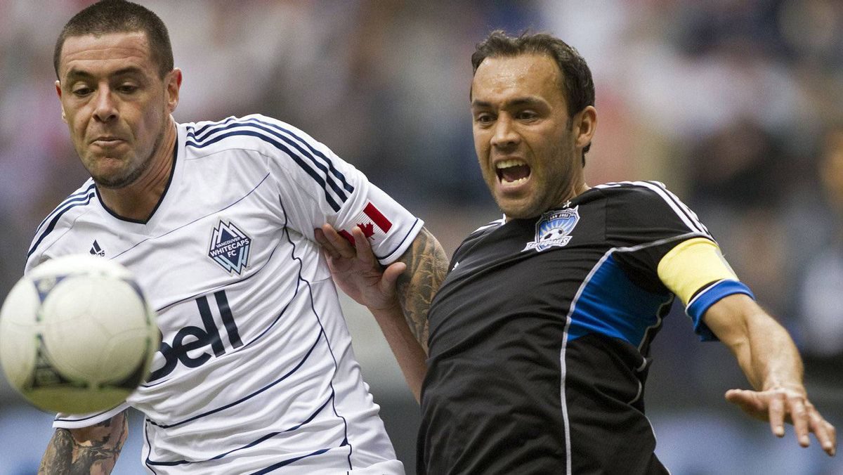 Vancouver Whitecaps Eric Hassli fights for the ball with San Jose Earthquakes Ramiro Corrales (R) during the second half of their MLS soccer game in Vancouver, British Columbia, May 5, 2012. REUTERS/Ben Nelms