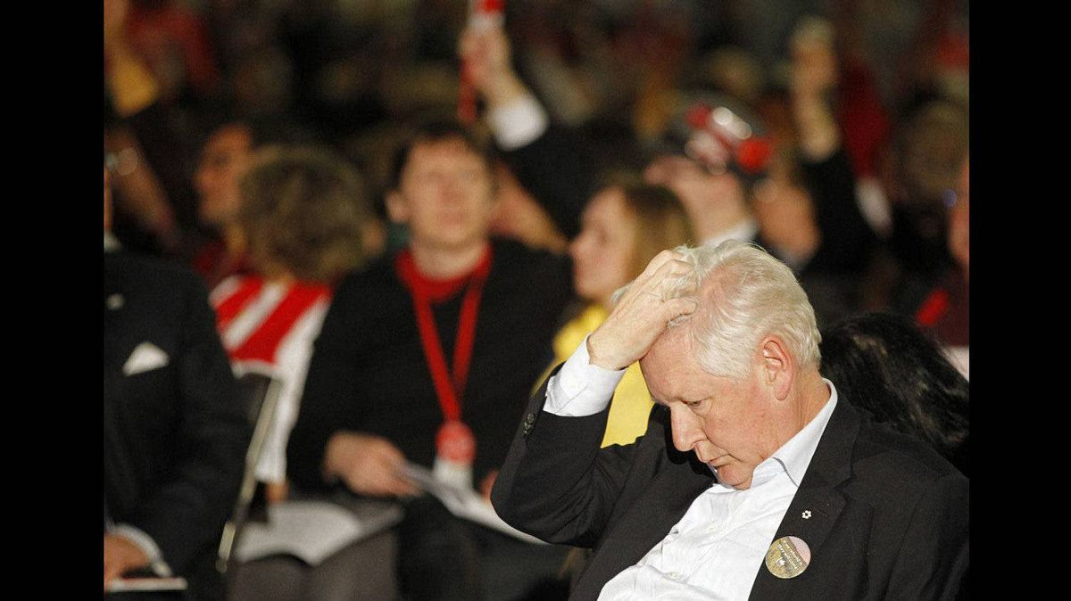 Interim Liberal Party leader Bob Rae scratches his head during a delay in voting for recommendations on day two of the Liberal Convention in Ottawa.