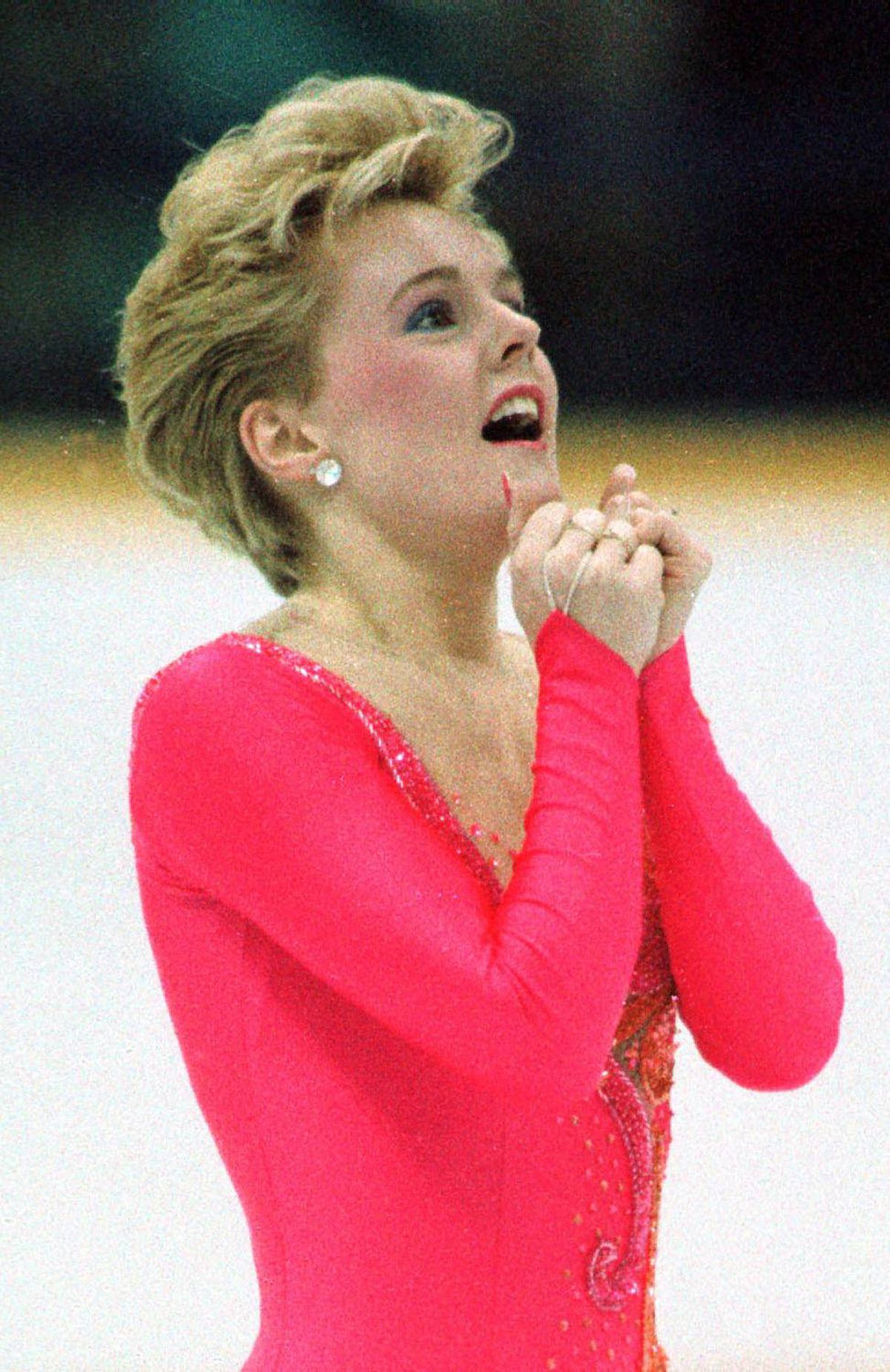 Elizabeth Manley clasps her hands together with delight after winning the free skating program in women's singles figure skating in Calgary in this February 1988 file photo. Manley has been named to the Canadian Figure Skating Hall of Fame.