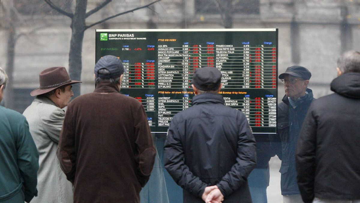 People stop and look at stock market in Milan, Italy.