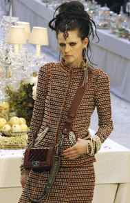 Chanel's Metiers D'Art is a collection of fall designs, arriving in-store before the main ready-to-wear line. Mostly, this is an occasion for Karl Lagerfeld to showcase the skillful craftspeople he works with. Metiers D'Art approximates couture as far as workmanship but is produced for retail. This was the first look.