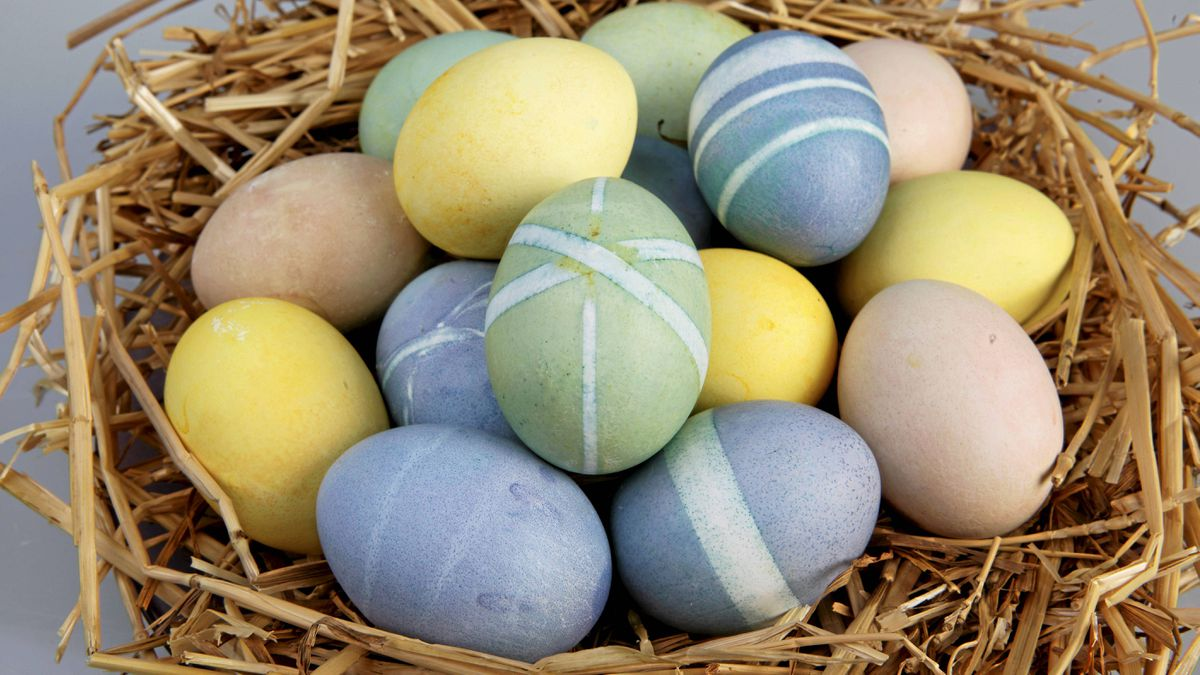 Easter eggs coloured with food such beets, red cabbage and turmeric.