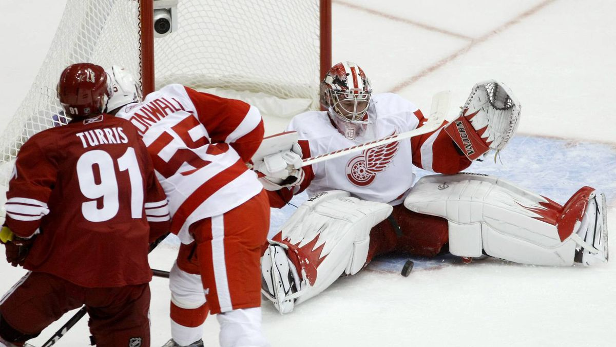 Detroit Red Wings goalie Jimmy Howard makes the save on Phoenix Coyotes center Kyle Turris in the second period of Game 4.