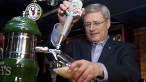 Prime Minister Stephen Harper pours pints of beer at the Red Stag tavern during a campaign stop in Halifax, Thursday March 31, 2011.