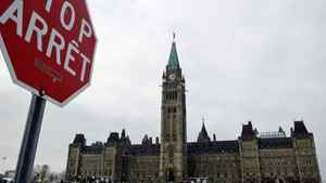 A stop sign is seen near Peace Tower in Ottawa on Dec. 30, 2009.