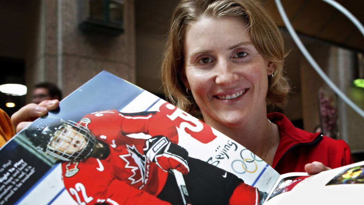 Canadian Olympic women's hockey player Hayley Wickenheiser holds her page open at the launch of an Olympic calendar fundraising project in Calgary, Thursday, Sept. 10, 2009. Proceeds from the calendars will support Right To Play sports programs across Africa, Asia, and South America.THE CANADIAN PRESS/Jeff McIntosh