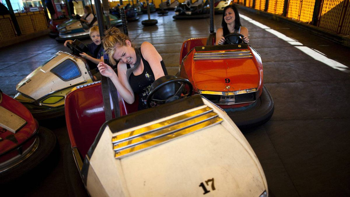 People bump each other while driving the Auto Scooters at the Pacific National Exhibition in Vancouver, British Columbia, Wednesday , August 17, 2011.