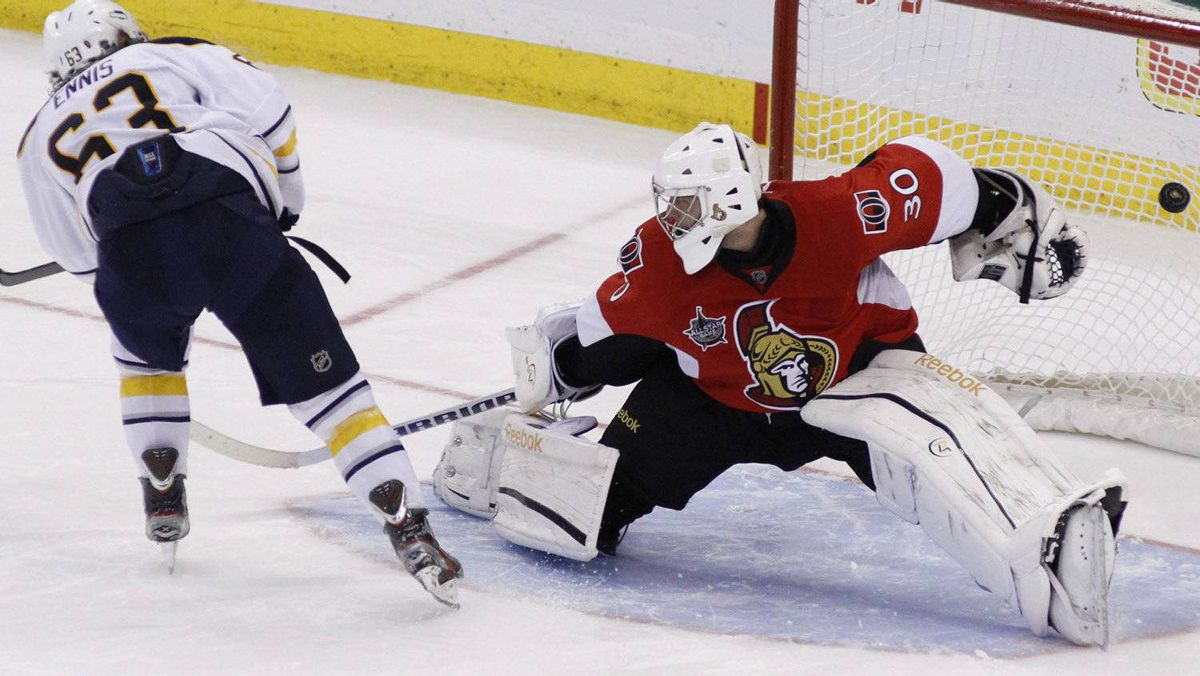 Ottawa Senators goaltender Ben Bishop (30) looks on as Buffalo Sabres Tyler Ennis (63) scores the winning shoot out goal beating the Ottawa Senators 2-1 in NHL hockey in Ottawa, Saturday March 10, 2012.THE CANADIAN PRESS/Fred Chartrand