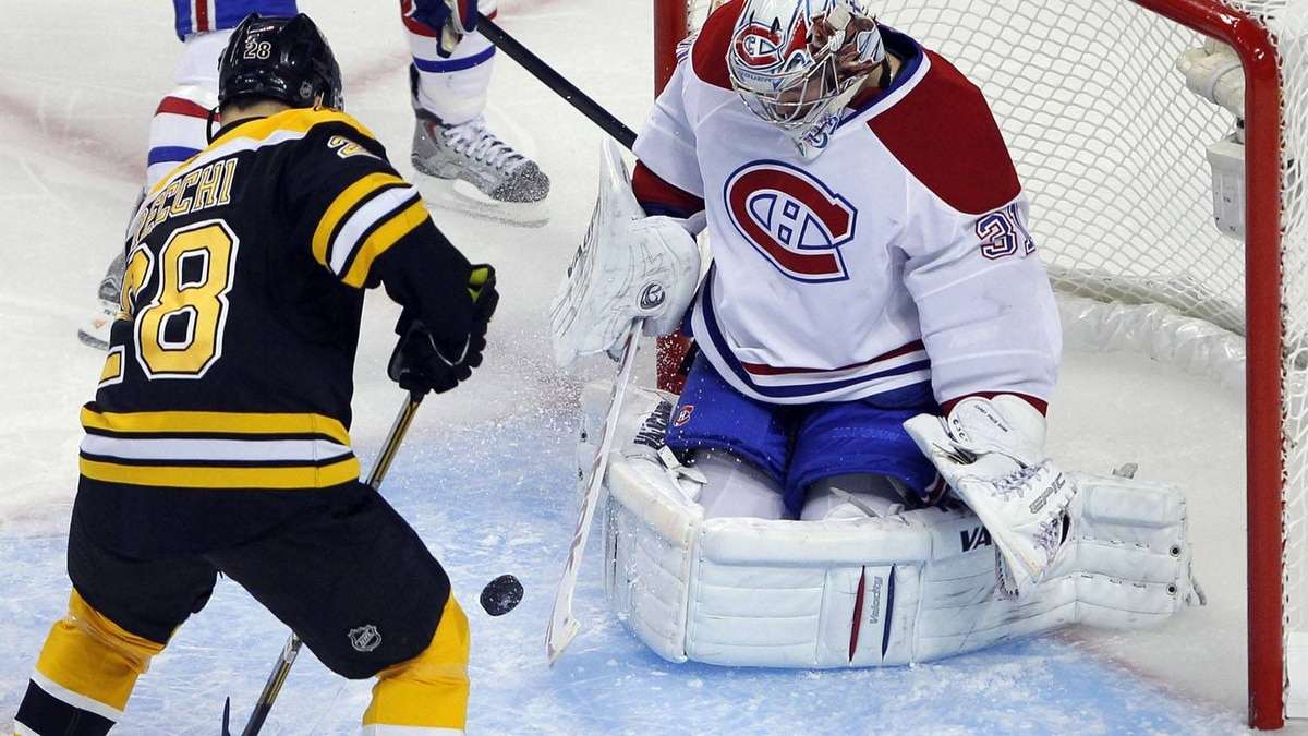 Montreal Canadiens goaltender Carey Price (R) makes a save against Boston Bruins left wing Mark Recchi during the first period in Game 5 of their NHL Eastern Conference quarter-final hockey game in Boston, Massachusetts, April 23, 2011. REUTERS/Brian Snyder