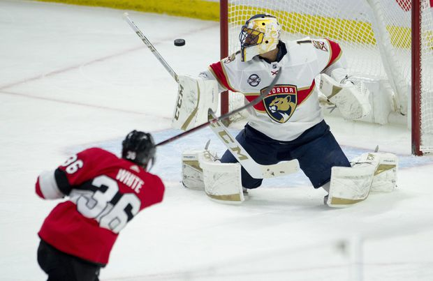 a590e17f56e Ottawa Senators centre Colin White fires the puck wide of the net past  Florida Panthers goaltender Roberto Luongo during a game in Ottawa on March  28