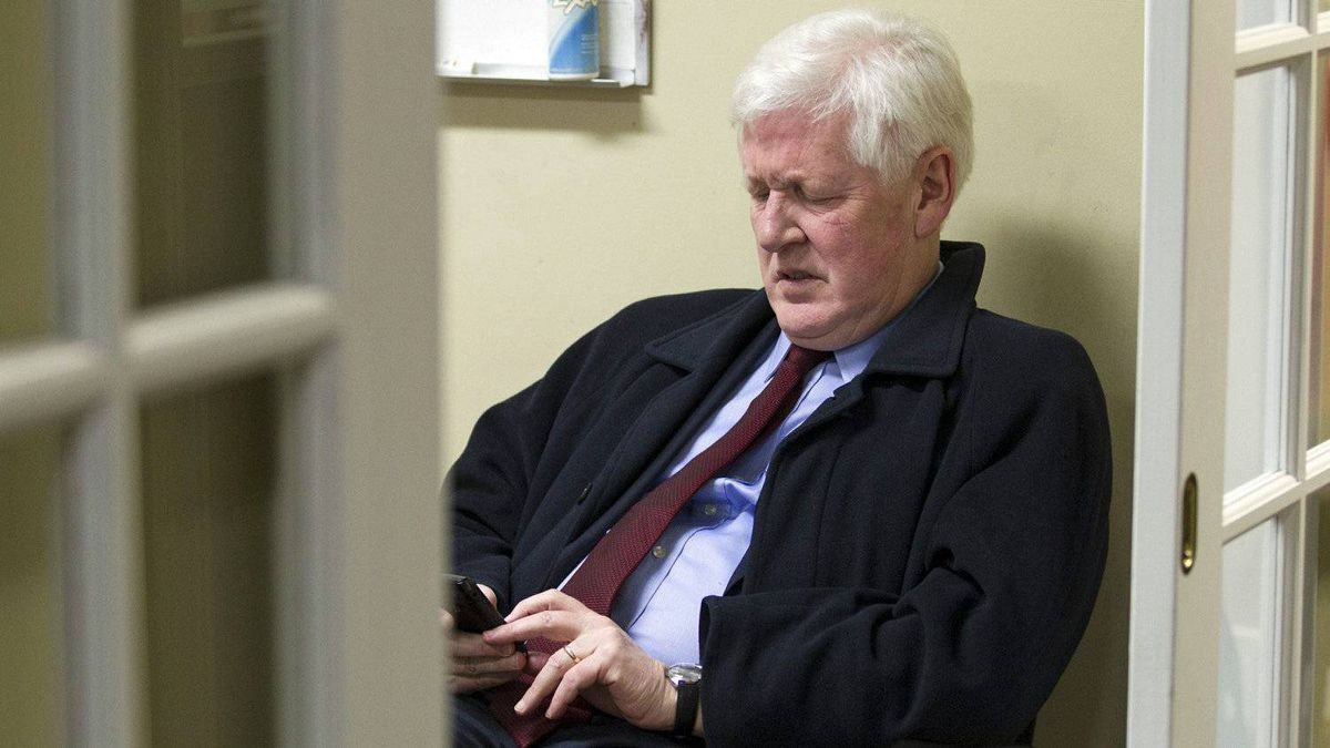 Liberal Leader Bob Rae checks his Blackberry after giving a year-end news conference in Toronto on Dec. 30, 2011.